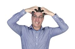 Nervous young glasses man tears his hair. With white isolated background Royalty Free Stock Image