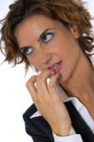 Nervously Biting Her Nails. A business woman in a suit, nervously biting her nails Stock Photo