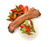 Nervure rôtie de porc du plat d'isolement sur le blanc photo stock