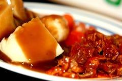 Nervures de barbecue avec des pommes de terre Photographie stock libre de droits