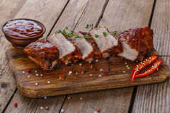Nervures de porc cuites au four Images stock