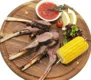 Nervures de porc frites avec de la sauce Images stock