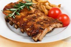 Nervures et légumes de porc Photo stock