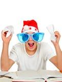 Nerwowy nastolatek w Santa kapeluszu Zdjęcie Stock