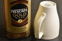 Nescafe Gold Blend instant coffee and cup Royalty Free Stock Photo