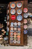 Nesebar, Bulgaria-08.15.2018: Traditional bulgarian ceramic plates and dishes on wall in the street market. Colorful clay stock photo