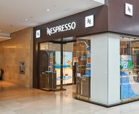 Nespresso boutique and logo royalty free stock photography