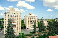 Three apartment houses of different stories. Ness Ziona, Israel-May 21, 2017: The 3 apartment houses of 8,7,3 stories are beige without balconies what is typical royalty free stock photo