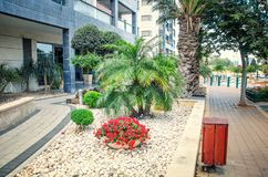 The passage for disabled, wheel chairs and trolleys at the entrance to condominium. Ness Ziona, Israel-May 21, 2017: The entrance to the multistory apartment royalty free stock image