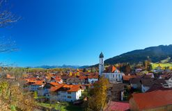 Nesselwang in Allgäu. Blue sky in autumn over Nesselwang in Allgäu, Bavaria, Germany, with the alps in the background Royalty Free Stock Photography