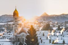 Cold winter sunrise over nesselwang stock photos