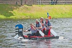 Nessie en raza de la balsa de Ness del río Imagen de archivo libre de regalías
