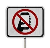 Nessun segno mandante un sms e movente fotografia stock libera da diritti