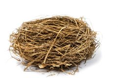 Nest in Center of Shot.  Focus on Front of Nest. Horizontal close-up shot of an empty bird`s nest on a white background Royalty Free Stock Images