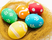 Nest with colorful Easter Eggs  Royalty Free Stock Images