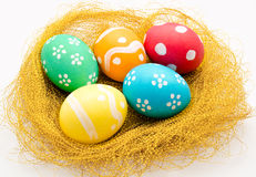 Nest with colorful Easter Eggs isolated Royalty Free Stock Image