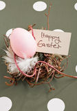 Nest With Easter Egg. Colored egg in a small nest with a Happy Easter tag Stock Images