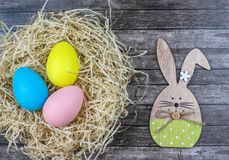 A nest with Easter eggs and bunny. royalty free stock photos