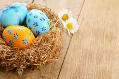 Nest with Easter eggs on the wooden  table Stock Image