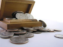 Nest egg. A macro of coins in a box suggesting savings or wealth royalty free stock image