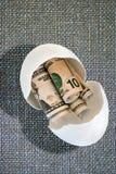 Nest egg on burlap background Royalty Free Stock Photo