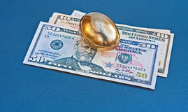 Nest egg held in US Dollars Stock Images