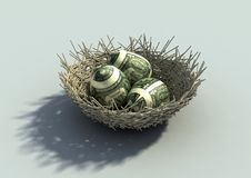 Nest Egg metaphor. With three eggs mapped with dollar bills Royalty Free Stock Images