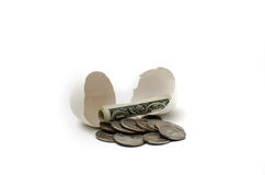 Nest Egg. Money hatched from an egg Royalty Free Stock Image