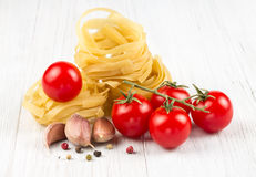 Nest egg noodles with tomatoes Royalty Free Stock Photo