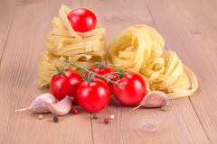 Nest egg noodles with tomatoes Stock Images