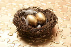 Nest Egg Strategy. A conceptual piece of managing to create a wealthy nest egg stock photography