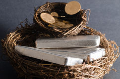 Nest Eggs of Gold Coins & Silver Bars. Nest Eggs of Gold Coins royalty free stock photo