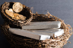 Nest Eggs of Gold Coins & Silver Bars.  royalty free stock image