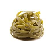 Nest of green tagliatelle isolated on white Royalty Free Stock Photography