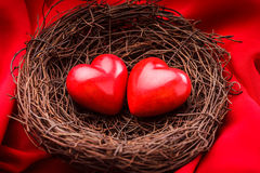 Nest with hearts. Little cozy nest with two red hearts. Valentine's day greetings concept Stock Image