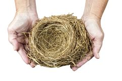 Nest Held in Woman`s Hands. Horizontal close-up shot of an empty bird`s nest being held in a woman`s hands.  White background Royalty Free Stock Image