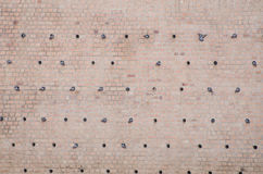 Nest holes in a brick wall for pigeons Stock Photos