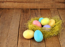 Free Nest Of Easter Eggs On Rustic Wood Royalty Free Stock Image - 28800566
