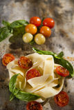 Nest of pasta with basil and tomato Stock Photos