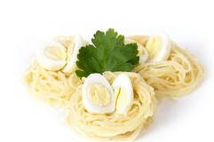 Nest pasta with quail eggs Stock Image