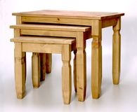 Nest of Tables. Nest of three pine coffee tables royalty free stock images