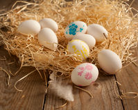 Nest with white eggs and painted eggs Royalty Free Stock Photos