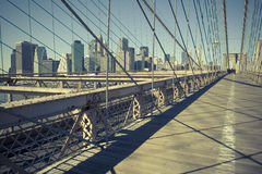 Nested city. Brooklyn Bridge and its net framed New York City Stock Photography