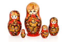 Nested dolls. The Russian nested doll is photographed on white Stock Images