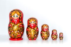 Russian Nested dolls on a white background. Nested dolls are arranged in a row on a white background. Frontal view of nested dolls Stock Photography