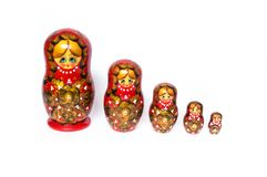 Nested dolls on a white background. Nested dolls are arranged in a row on a white background. Top view of nested dolls Stock Photos