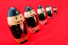 Nested Nutcrackers on Red 2 Royalty Free Stock Photos