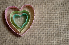 Nested Pastel Hearts on Burlap Stock Photography
