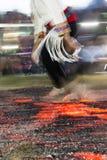 Nestinar die op brand lopen Stock Foto's