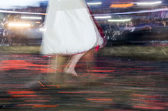 Nestinar woman walking on fire Royalty Free Stock Image